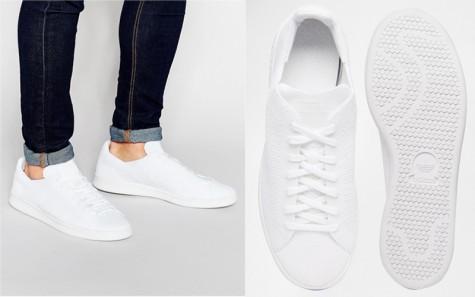 Một sản phẩm trainer trắng tối giản của thương hiệu ADIDAS.