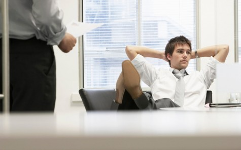 Businessman Reclining On Chair And Ignoring Boss