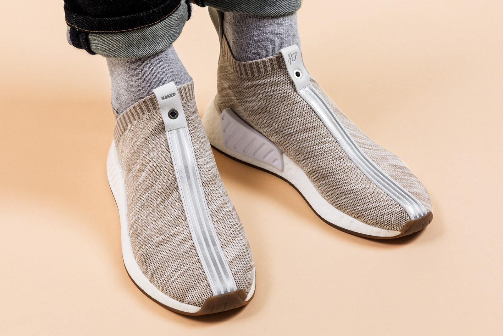 giay the thao adidas 2017 - Kith x Naked x adidas Consortium NMD City Sock - elle man 2
