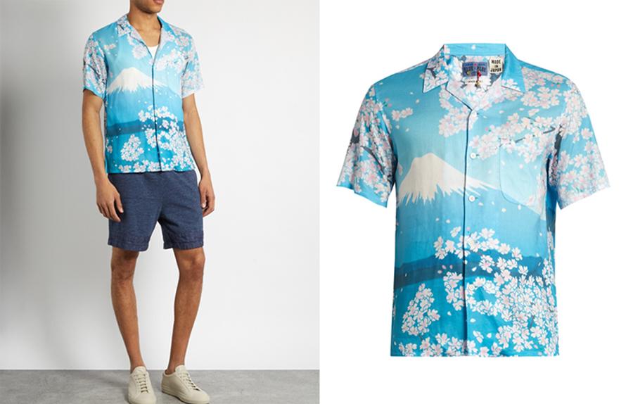 Chiếc áo sơ-mi của Blue Blue Japan đưa chúng ta nhìn vào một bầu trời Hạ trong xanh cao vợi của nước Nhật với hoa anh đào và Phú Sĩ sơn. Chiếc áo được làm ra bởi kỹ thuật nhuộm màu xanh indigo (nhuộm vải denim) truyền thống của người Nhật.