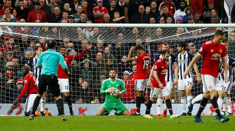 "Soccer Football - Premier League - Manchester United vs West Bromwich Albion - Old Trafford, Manchester, Britain - April 15, 2018 West Bromwich Albion's Ben Foster hold the ball Action Images via Reuters/Jason Cairnduff EDITORIAL USE ONLY. No use with unauthorized audio, video, data, fixture lists, club/league logos or ""live"" services. Online in-match use limited to 75 images, no video emulation. No use in betting, games or single club/league/player publications. Please contact your account representative for further details."