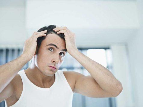 Chống nắng cho tóc là một trong những bước quan trọng thường bị bỏ quên. Photo: Menshelth