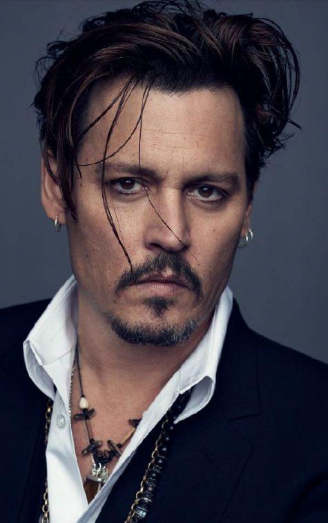 Tài tử Johnny Depp bị kiện bởi hai vệ sĩ cũ của mình.