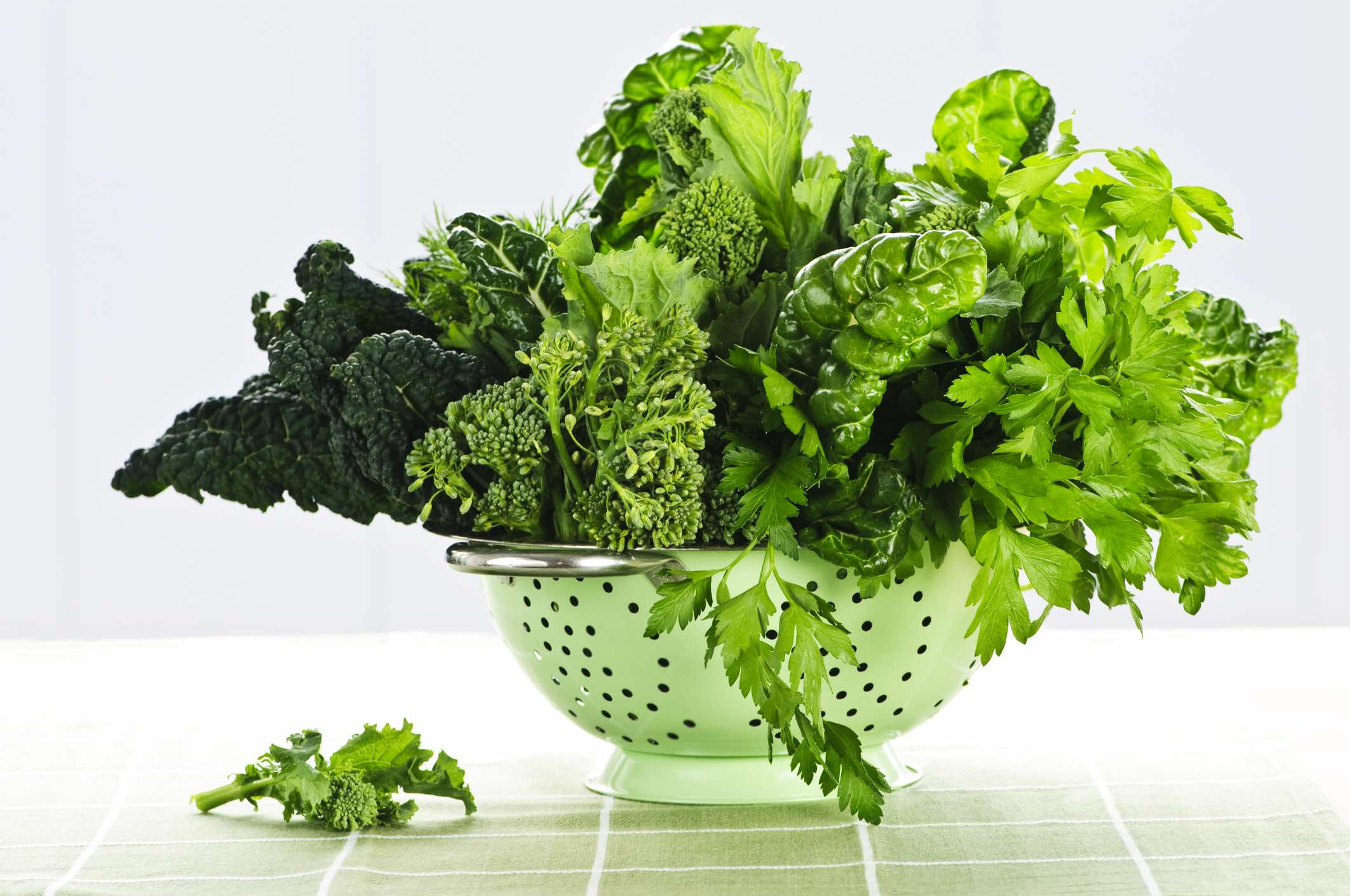 Dark green leafy vegetables in colander
