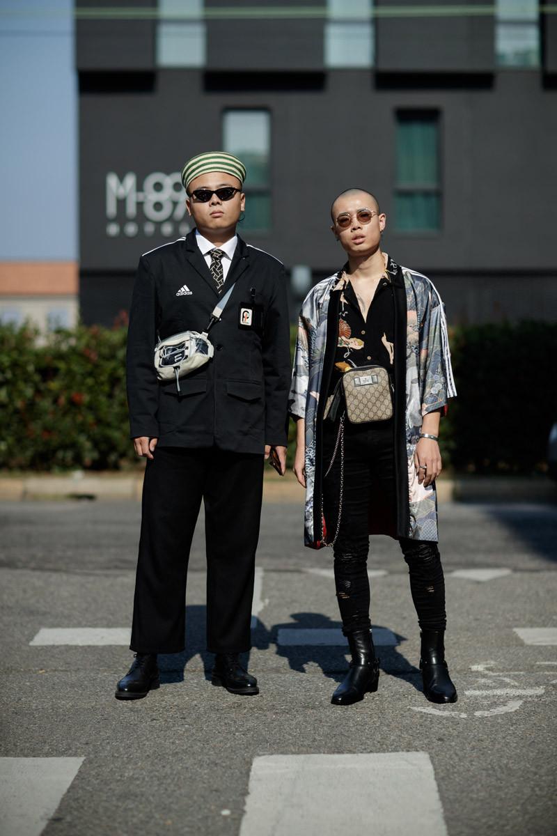 Quần áo công sở đi cùng với tinh thần thể thao năng động của jacker adidas hay túi đeo chéo thời thượng mang đến cái nhìn ấn tượng cho chàng fashionisto này. Ảnh: IMAXTREE