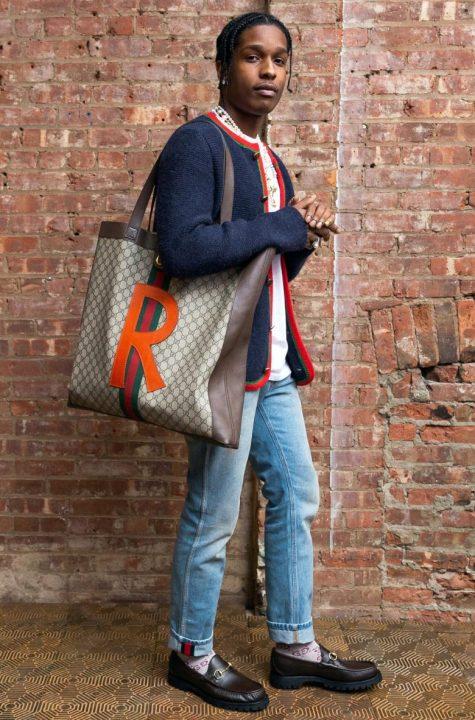 Ngôi vị á quân chính thức thuộc về rapper A$AP Rocky với việc không ngại trải nghiệm mình ở khía cạnh thời trang và tạo ra chỗ đứng cho xu hướng mặc đồ unisex. Áo khoác cardigan đi cùng quần denim và giày loafer kinh điển của Gucci như được tiếp thêm sức mạnh với chiếc túi tote bản to mang đến hình ảnh nhẹ nhàng và có phần nữ tính. Tuy nhiên anh chàng vẫn ghi điểm bằng gout thẩm mỹ độc lạ của mình. Ảnh: Gucci