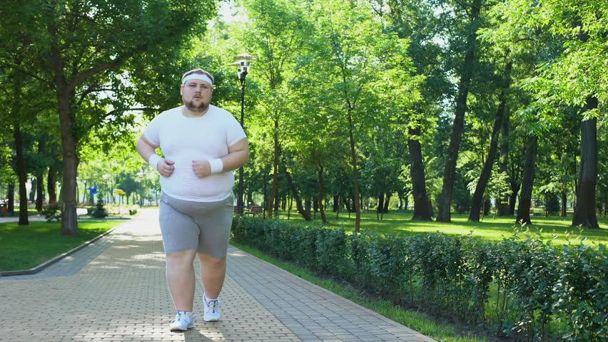 người đang ông mập mạp đang chạy bộ
