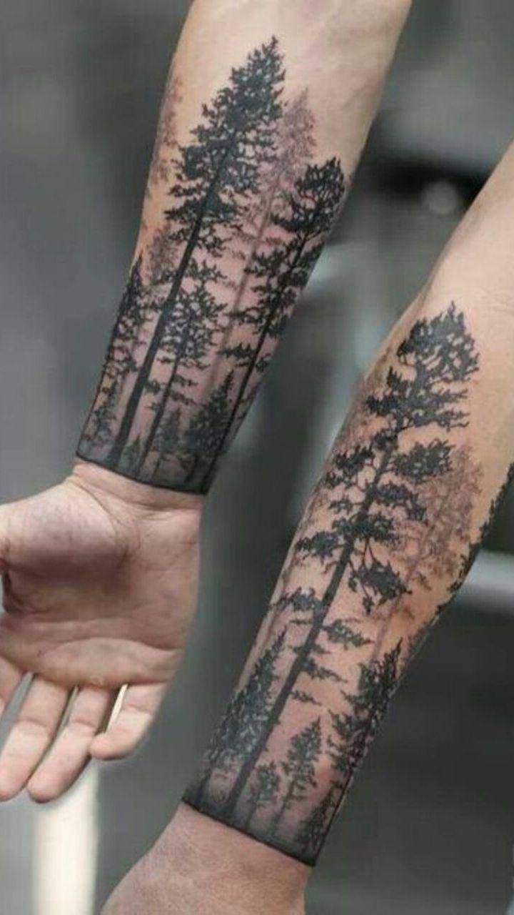 hình ảnh rừng cây được khác trên cánh tay người đàn ông - hình xăm nam giới - 2019 - elle man