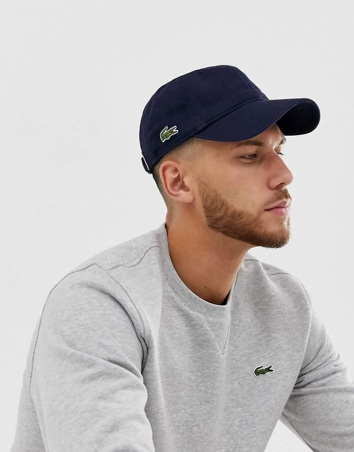 xu hướng thời trang - nón lưỡi trai - thương hiệu lacoste - thu đông - 2019 - elle man