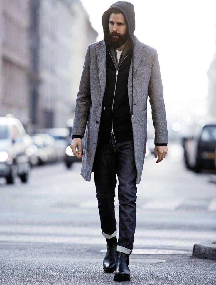 chàng trai mặc trang phục đen với áo khoác ngoài màu xám.